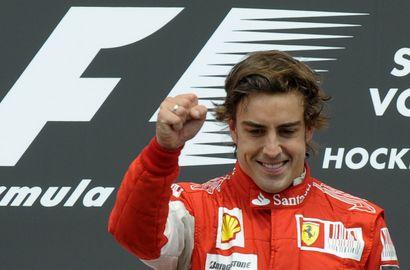 """Сегодня. Хоккенхайм. Фернандо АЛОНСО празднует победу на """"Гран-при Германии"""". Фото AFP Фото AFP"""