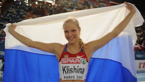 Сегодня. Париж. Дарья КЛИШИНА после победы в прыжках в длину. Фото AFP Фото AFP