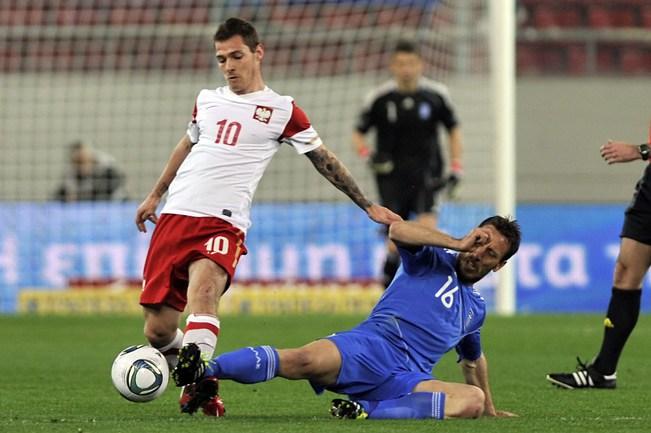 29 марта 2011 года. Афины. Греция - Польша - 0:0. Людовик ОБРАНЬЯК (слева) и Пантелис КАФЕС Фото AFP