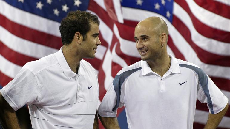 8 сентября 2002 года. Нью-Йорк. Пит САМПРАС (слева) и Андре АГАССИ после финала US Open. Фото AFP