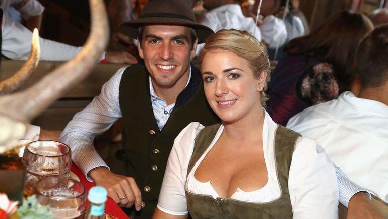 Филип ЛАМ с женой Клаудией. Фото AFP