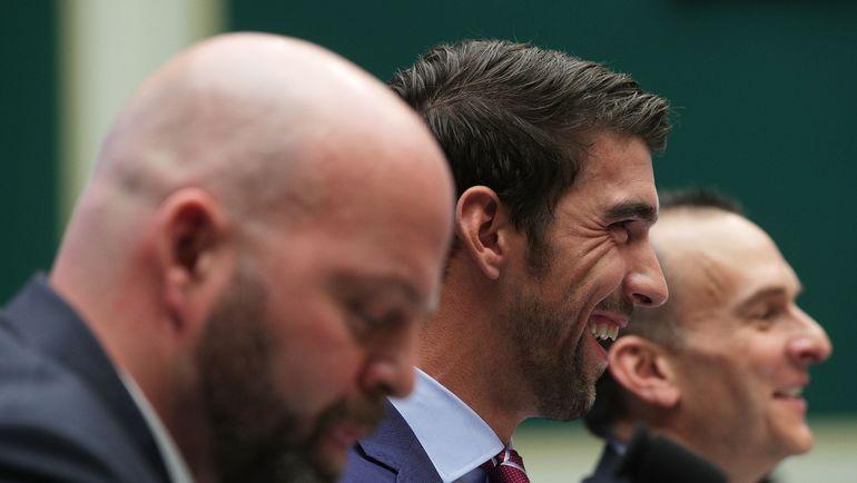 Трэвис ТАЙГАРТ (справа), Майкл ФЕЛПС (в центре) и Адам НЕЛЬСОН. Фото AFP