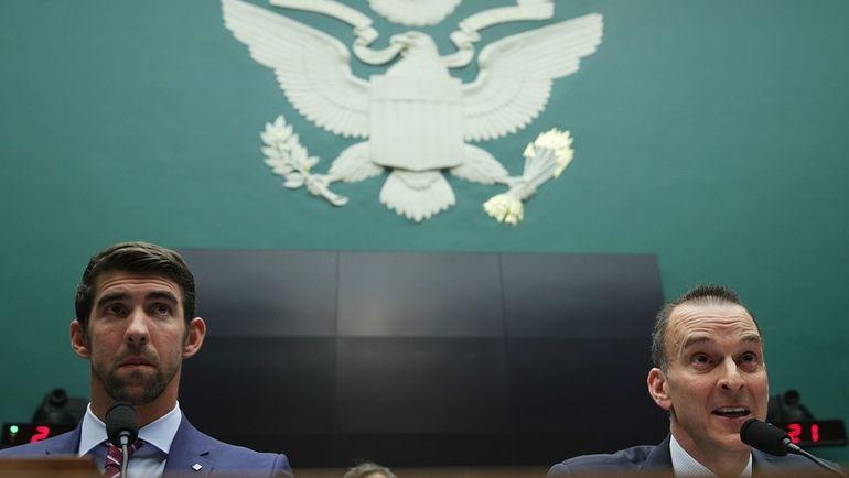 Трэвис ТАЙГАРТ (справа) и Майкл ФЕЛПС. Фото AFP