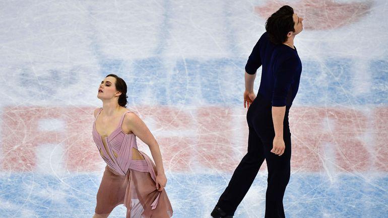 Сегодня. Хельсинки. Чемпионы мира Тесса ВИРТУ и Скотт МОИР. Фото AFP