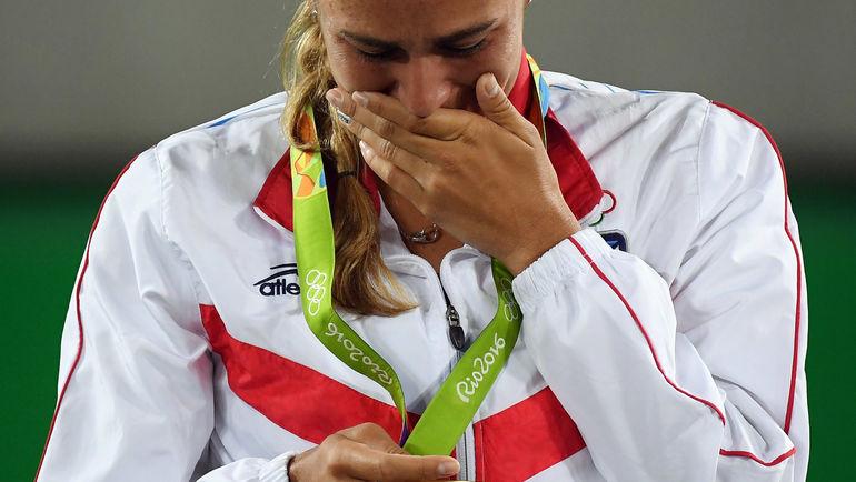 13 августа 2016 года. Рио-де-Жанейро. Моника ПУИГ с золотой олимпийской медаль. Фото REUTERS